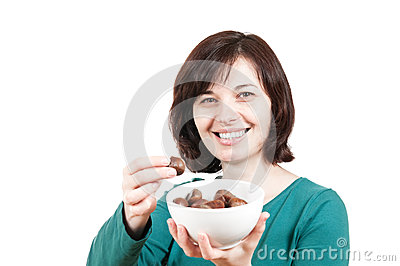 Smiling woman with bowl of chestnuts