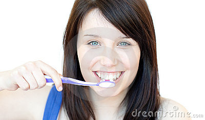Smiling woman brushing her teeth