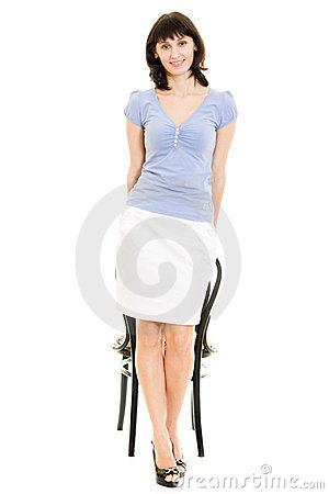 Smiling woman with a chair