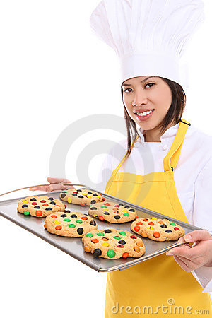 Smiling Woman Chef with Tray of Cookies