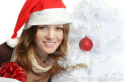 Smiling woman with Christmas tree