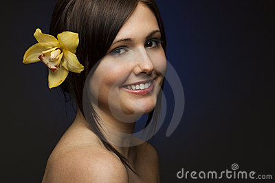 Smiling woman on dark blue background