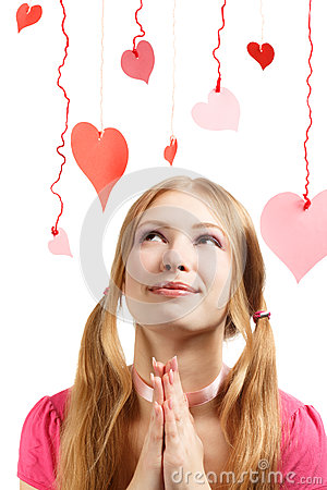 Smiling woman with designer red and pink paper valentine hearts