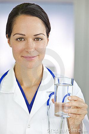 Smiling Woman Doctor Holding Glass of Water