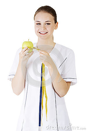 Free Smiling Woman Doctor With A Green Apple And Measuring Tape. Stock Photography - 31273552