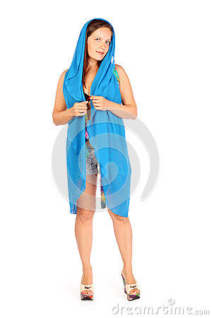 Smiling woman dressed in shorts and scarf poses