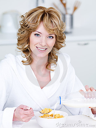 Free Smiling Woman Eating Corn Flakes Royalty Free Stock Photography - 14076927