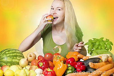 Smiling woman eating fruit