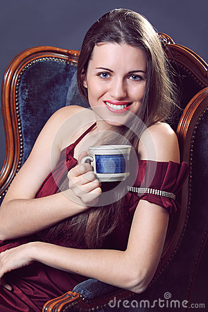 Smiling woman with a cup of coffee