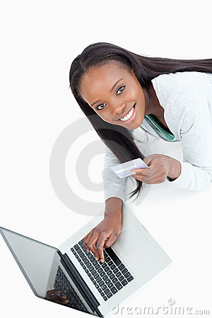 Smiling woman entering credit card information