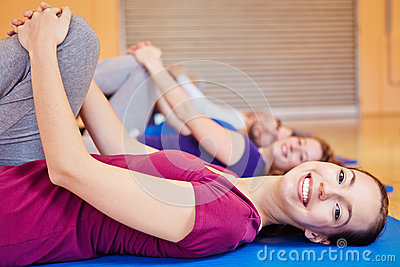 Smiling woman in fitness class