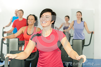 Smiling woman at fitness class gym workout