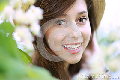 Smiling woman with flowering tree