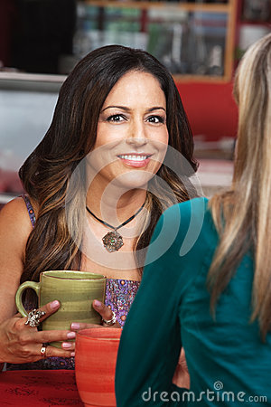 Smiling Woman with Friend in Cafe