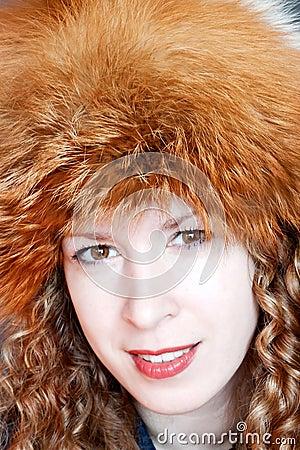 Smiling woman in fur hat
