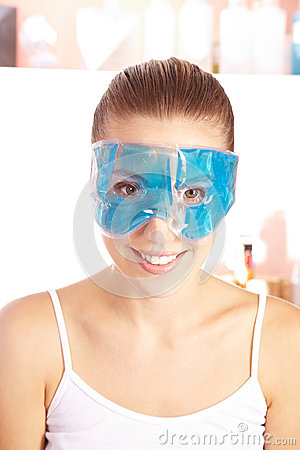 Smiling woman with gel mask
