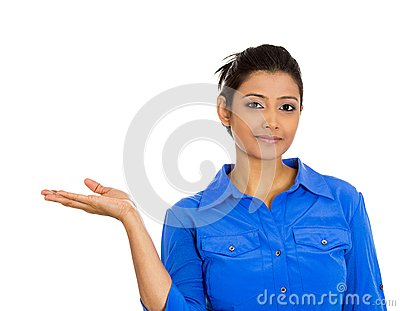 Smiling woman gesturing to space at left