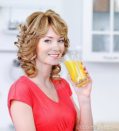 Smiling woman with a glass of juice