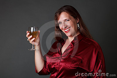 Smiling woman with glass of white wine