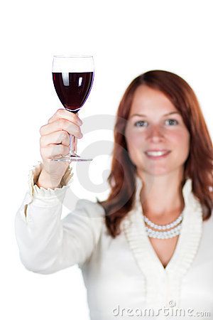 Smiling woman with glass of wine.