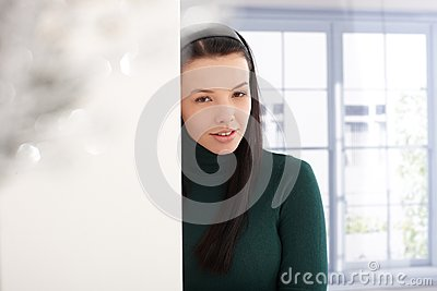 Smiling woman in green pullover