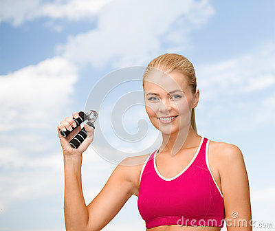 Smiling woman with hand expander