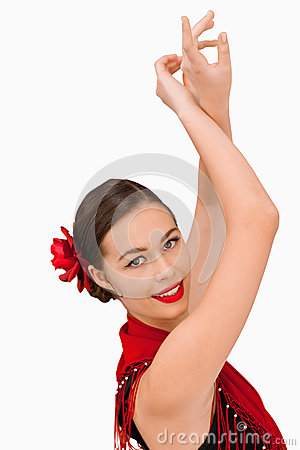 Smiling woman with her arms raised