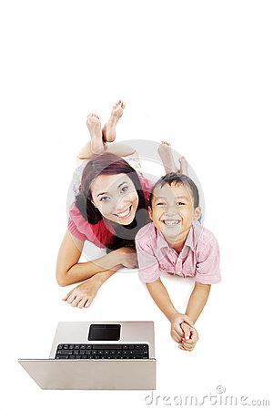 Smiling woman and her son with laptop