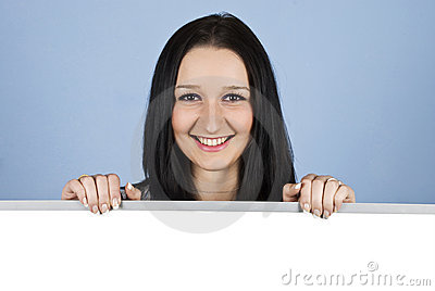 Smiling woman holding a blank banner