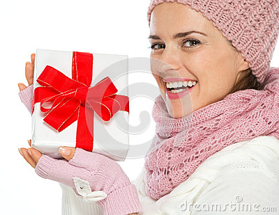 Smiling woman holding Christmas present box