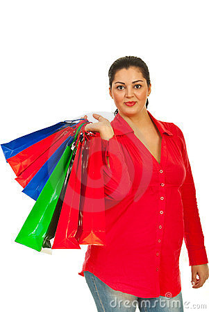 Smiling woman holding colorful bags