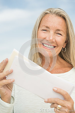 Smiling Woman Holding Envelopes Against Sky