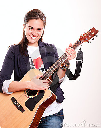 Smiling woman holding guitar