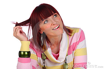 Smiling woman holding her hair, isolated