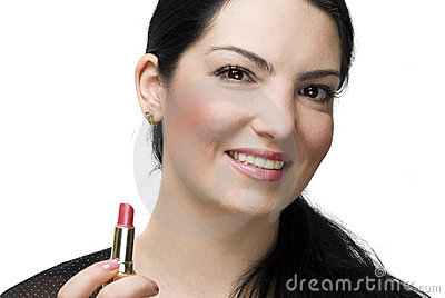 Smiling woman holding lipstick