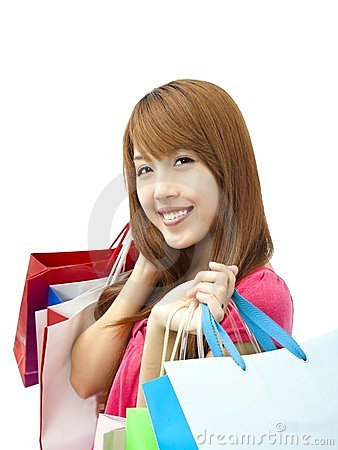 Smiling woman holding shopping bag