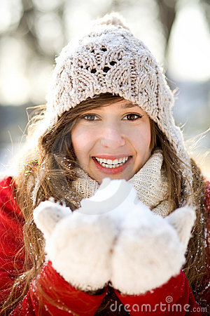 Smiling woman holding snow