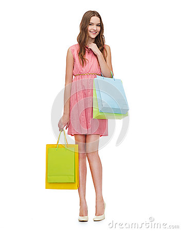 Free Smiling Woman In Dress With Many Shopping Bags Royalty Free Stock Photography - 39639107