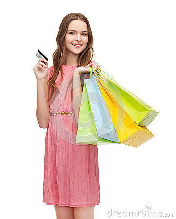 Free Smiling Woman In Dress With Many Shopping Bags Royalty Free Stock Photos - 39639178