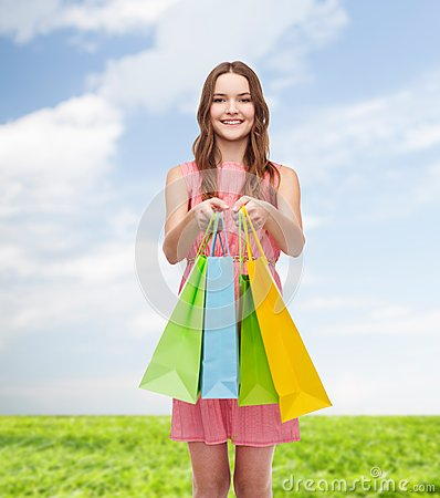 Free Smiling Woman In Dress With Many Shopping Bags Stock Photography - 39785642