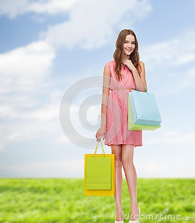 Free Smiling Woman In Dress With Many Shopping Bags Royalty Free Stock Photo - 39785645