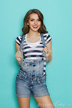 Free Smiling Woman In Dungarees Royalty Free Stock Image - 62500086