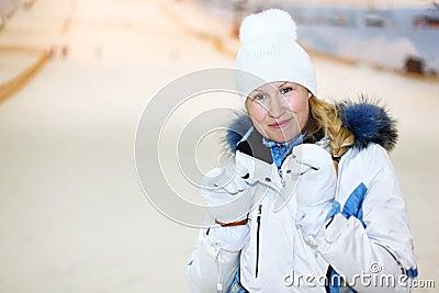 Smiling woman in indoor ski