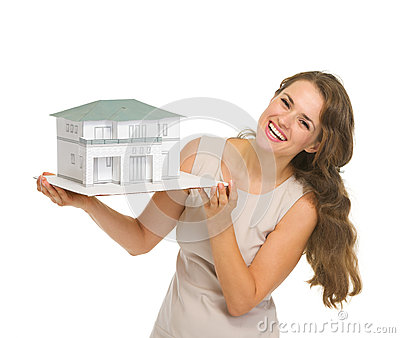 Smiling woman landlord with scale model of house
