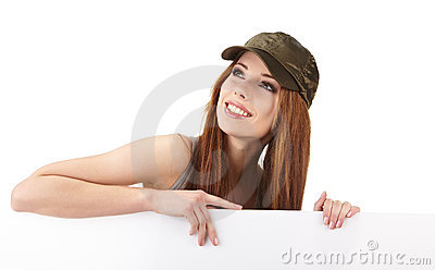 Smiling woman leaning on blank board