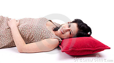 smiling woman lying on the red pillow