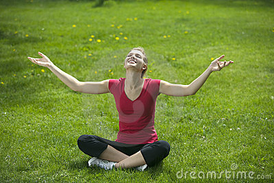 Smiling woman meditating