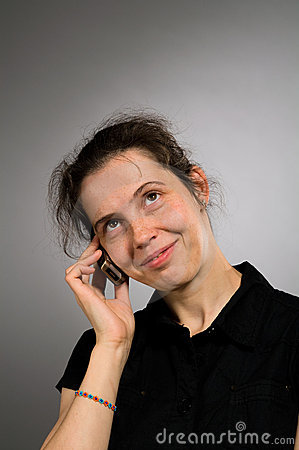 Smiling woman with mobile