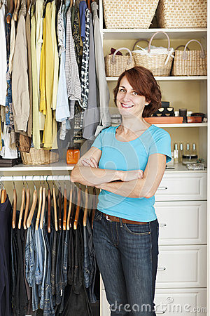 Smiling woman near closet