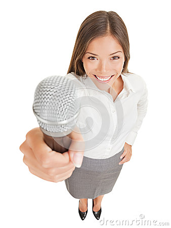 Smiling woman offering up a microphone